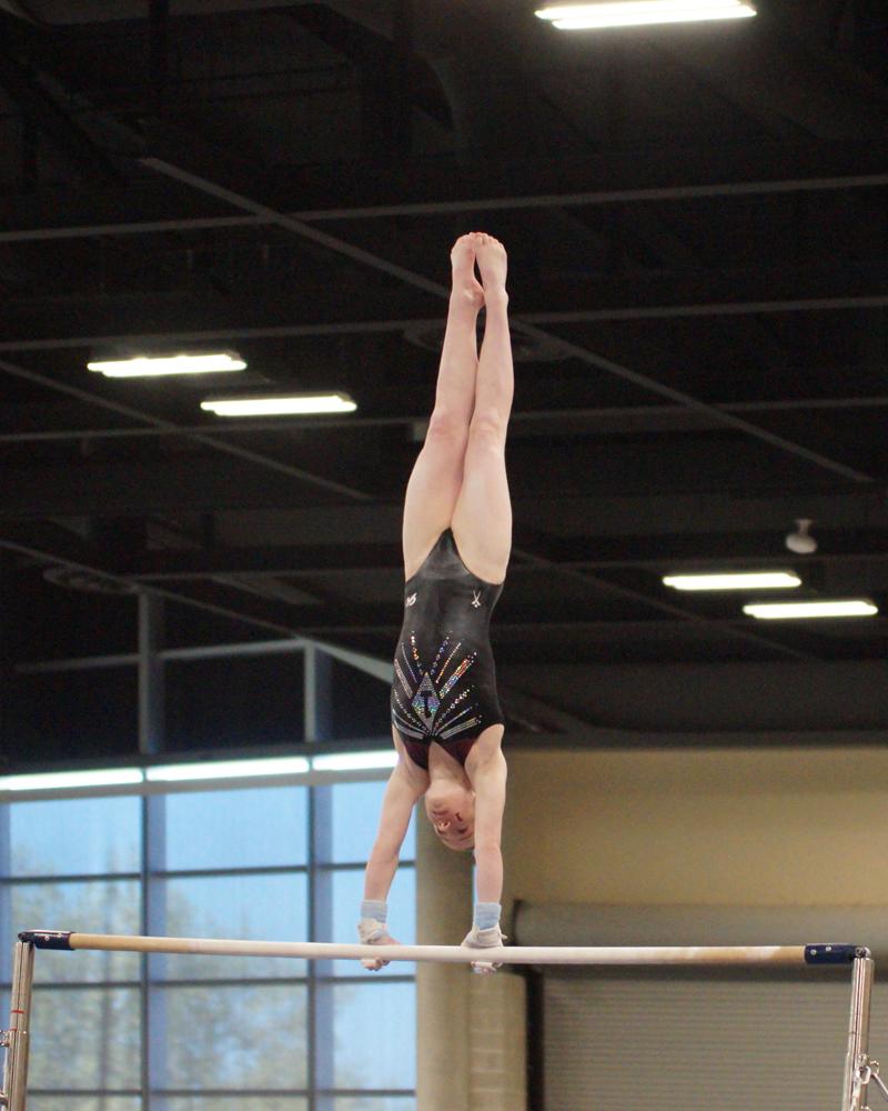 Bridget Kemp handstand on bars