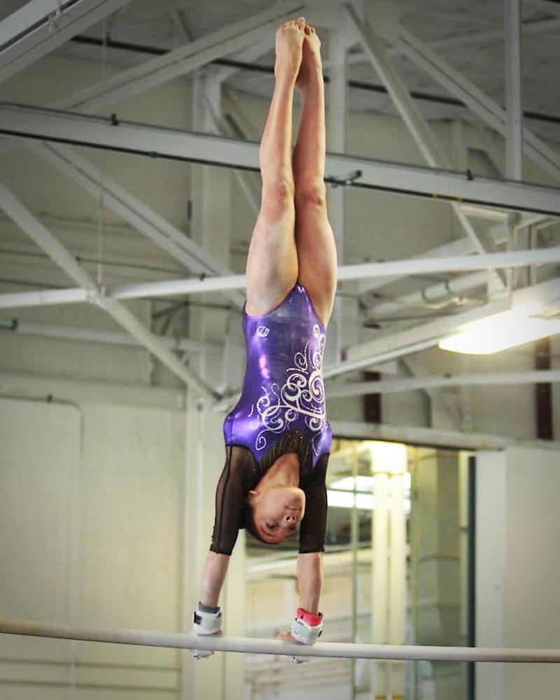 Maliyah James, handstand on top bar